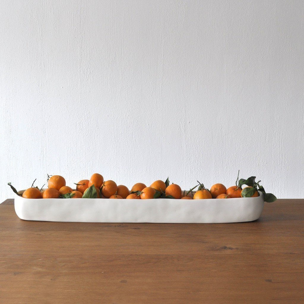 California. San Francisco designer Tina Frey makes modern, food-safe resin products for the home, from tabletop items to wall hooks and ice buckets.  Reasons to Love Design Made in America by Dwell