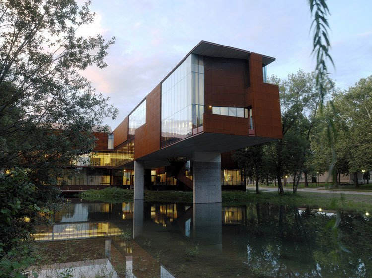 Iowa. The School of Art & Art History at the University of Iowa was designed by Steven Holl in 2006. Cantilevered over a pond, the structure nicely marries contemporary architecture and natural landscape.  Reasons to Love Design Made in America by Dwell