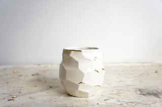 Nebraska. Emily Reinhardt, the designer behind blog and shop the Object Enthusiast, shapes ceramic heirlooms for modern traditionalists. Vessel 4 in her geometric Faceted collection glistens with gold lustre accents.