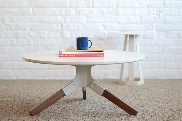 Wisconsin. Misewell's approach to modern furniture-making prioritizes ease of assembly. Each leg of the walnut Conrad coffee table snaps effortlessly into a steel bracket, which is available in a range of colors.