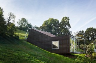 "Architect Christian Tonko played with a double metaphor when designing the Camera Lucida studio. The name of the cantileverd hillside space, Latin for ""bright chamber,"" references the open window facing the valley below, as well as the skylight that bathes the workspace in natural light."