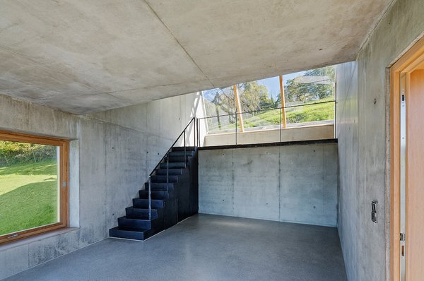 The single skylight helps light the artists' workstation. The simple interior, really a shed with smooth concrete surfaces, provides a stark yet airy space for creative pursuits.
