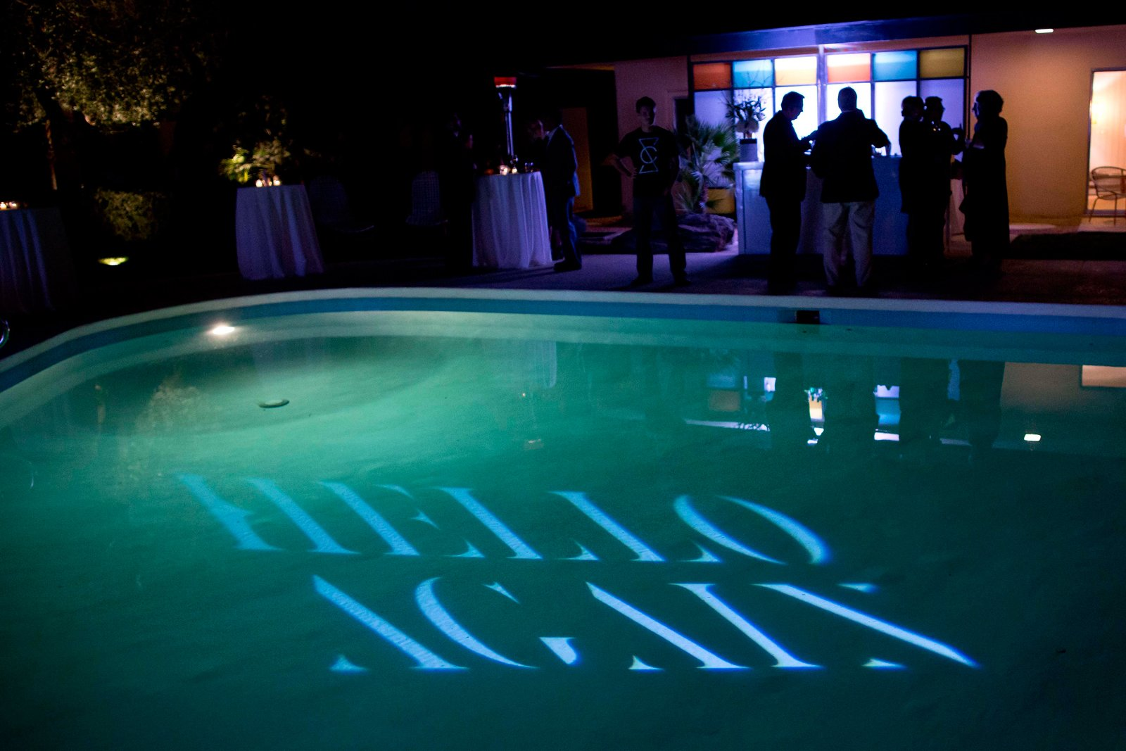 "Guests mingled around the pool. Hello Again welcomed partygoers to rethink the typical dinner party.  Search ""events-this-weekend-318-21.html"" from Dinner with Dwell & Lincoln"