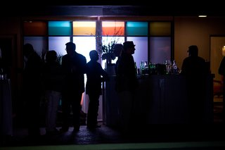 Silhouetted partygoers enjoying the atmosphere.