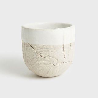 Tall Stoneware Zen Cup, $50, by Materia Lumina for Dara Artisans  This piece comes in right at $50: Handmade by Belgian native Eefje Theeuws in her Joshua Tree, California, studio, the Zen cup is part of a larger line of stoneware crafted to show every nuance of the natural material.