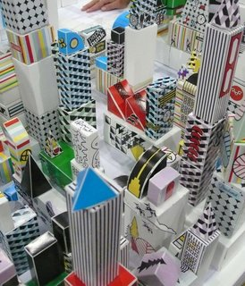 Grace Hawthorne of Paper Punk led a weekend-long interactive exhibit in which attendees used pieces from her Urban Fold Kit to build a giant, paper metropolis.