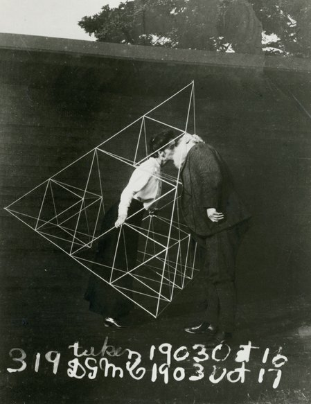 Alexander Graham Bell gives his wife, Mabel, a smooch in a tetrahedral kite, October 1903. Photo courtesy Library of Congress.