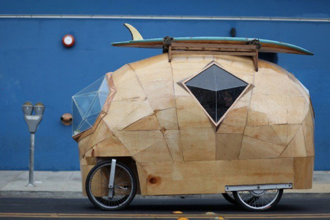 Designed by SF-based artist Jay Nelson, the Golden Gate is a modern electric camper car made with fiberglass, epoxy resin, plywood, glass, bike parts, and an electric motor. Comes with a kitchen, stove, cooler, storage cubbies, toilet, bed, and storage below the bed. And get this—the driver sits cross-legged while operating the vehicle.  ZOLLAMT