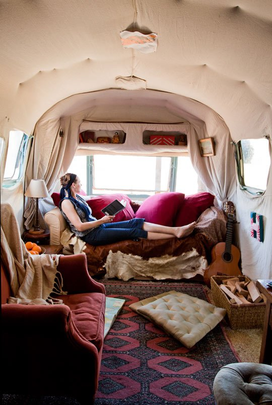About a mile from the Pacific Ocean on a tropical fruit farm lies Julie Montgomery's (seen here) renovated Airstream home which she shares with her son, Henry. Via Apartment Therapy.  Cool Airstreams by Eujin Rhee