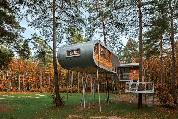 The cabin's curved zinc shell exudes a rugged, industrial look.