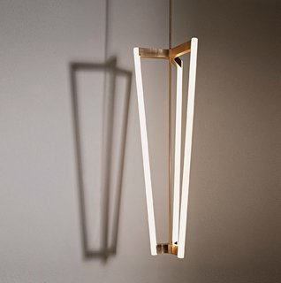 With its four rods, the Tube Chandelier casts a striking shadow when lit. Available in either satin brass or black plated stainless steel.