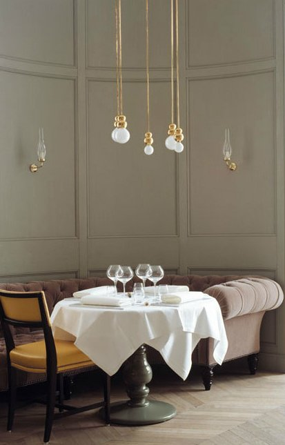 A quintet of Ball Lights hang above a pristinely-set dining table at the Grand Hôtel Stockholm's restaurant, designed by Ilse Crawford.  60+ Modern Lighting Solutions by Dwell from Lighting Designer We Love: Michael Anastassiades