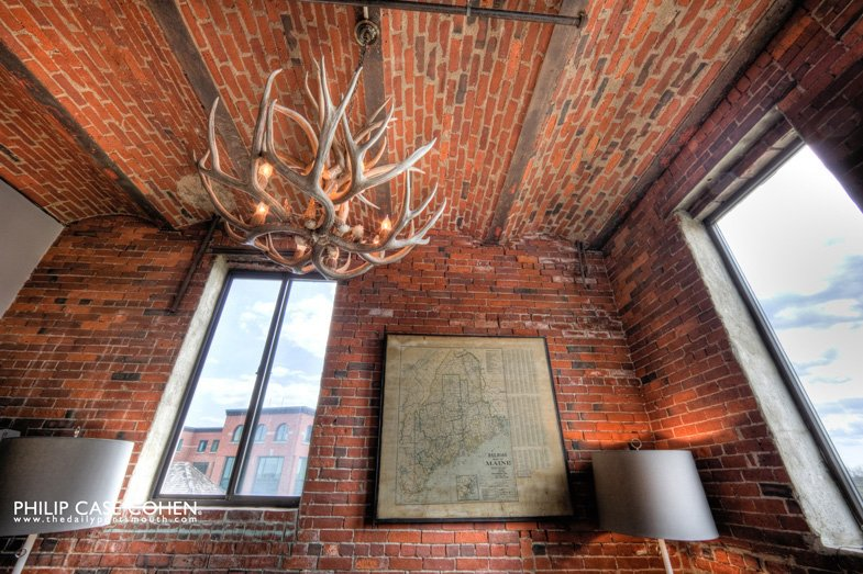 An antler chandelier hangs above the lobby waiting room.  Hotel Focus: Ale House Inn by Anna Goldwater Alexander