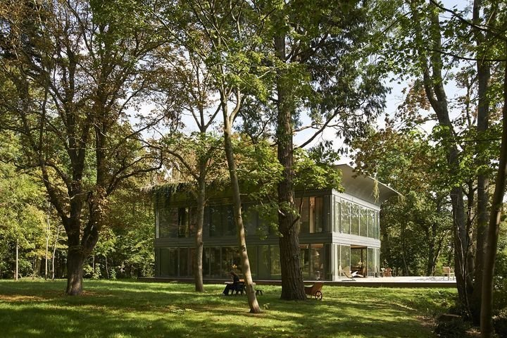 French designer Philippe Starck worked with Slovenian prefab builder Riko to create an ecologically minded prototype called P.A.T.H. The first of its kind is built at a wooded test site in Montfort l'Amaury, near Paris.  Modern Homes in the Forest by Brandi Andres