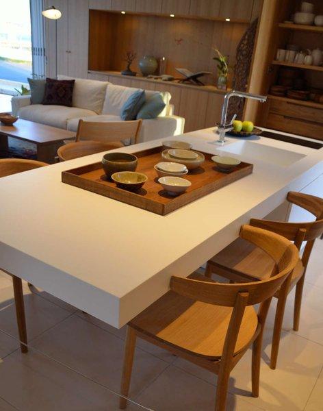 Legless kitchen island by Shigeru Ban, MUJI chairs by Naoto Fuksawa.