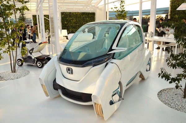 Sou Fujimoto collaborated with Honda on this high-tech home that integrates energy generation systems with the living space and family car. Solar roof panels charge the batteries on this electric vehicle parked in the light-filled living room.