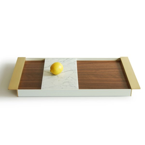 The Perimeter Tray from Ladies & Gentlemen Studio is a simple piece with a complex mix of materials— the tray combines a walnut surface with a Carrara marble insert, brass handles, and a powder-coated aluminum perimeter. The marble insert can serve as a plate or cheeseboard, and can be repositioned within the tray to be used as a decorative divider. Also available in oak, the Perimeter Tray makes an excellent housewarming or wedding gift.