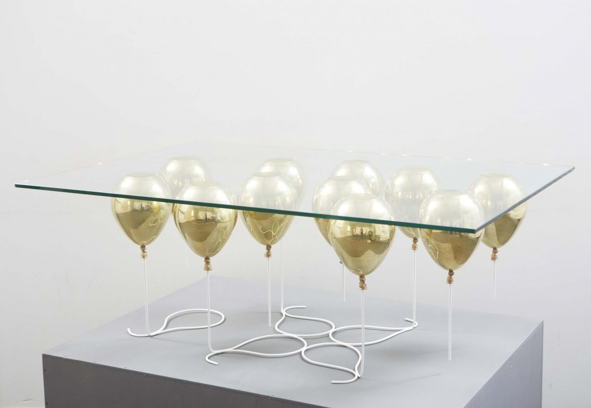 THE UP COFFEE TABLE  For a touch of whimsy and shine we love this handmade, buoyant-like, trompe-l'œil table which slyly gives off the impression that a piece of glass is being levitated by small golden balloons.  Photo 2 of 3 in Product Spotlight: The UP Coffee Table