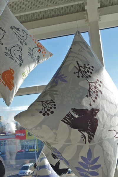 """Textiles by Sveinbjörg-Being forced to rethink your whole profession and output is no simple task. In the case of life-long artist Sveinbjörg Hallgrímsdóttir, the change was born out of the nation's financial strife. """"The collapse of the Icelandic economy forced us to think about how to be more commercial, more marketable, around the globe,"""" claimed the designer. For Hallgrímsdóttir, the answer was to transfer her painted motifs and wood block prints to textiles and other home accessories. The international outlook forced on many local designers also reached Hallgrímsdóttir's manufacturing. All her textiles are produced and distributed from Sweden, but her own store is still located in the northern Icelandic town of Akureyri with a population of just under 18,000. Photo by: Tiffany Orvet"""