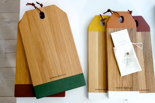 """Cutting boards by Reykjavik Trading Co.-Designer Anthony Bacigalupo grew up in a very different environment from the one he now calls home. With the culture, climate, and aesthetics of central California as early reference he and his Icelandic girlfriend Ýr Káradóttir now combine a nowhere-but-there Pacific Coast aesthetic with vintage Icelandic design. """"Our focus is on sustainability,"""" explained Bacigalupo. """"Our serving boards are painted with natural and food-safe milk paint."""" The color-blocked oak boards made it on to my mental wish list. Would I use them for their intended purpose? Maybe not, but just like many of the products from companies Bacigalupo has worked with before (Apple, Bang and Olufsen), there is a certain must-have quality to them. The oak is grown in Kentucky which makes me question their eco credentials somewhat, but I like the way they look and the feelings they trigger. Photo by: Tiffany Orvet"""