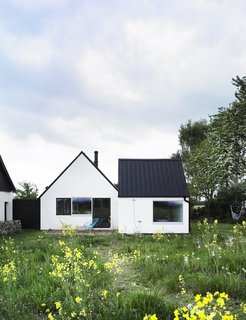 """Set in the Swedish summer retreat area of Österlen, this conversion of an abandoned farmhouse re-thinks and plays on the notion of """"nostalgia and shelter by combining them with very contemporary desires for space, light and nature,"""" say the architects. Photo by Thomas Ibsen."""