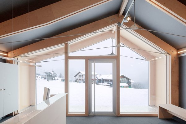 """Girodo says the """"high insulation performance of the shell"""" allows the building to function in a setting that experiences significant temperature fluctuations and extreme cold. Occupants of the front room, which functions as a reception area, can take in the views from its full-height windows in complete comfort."""