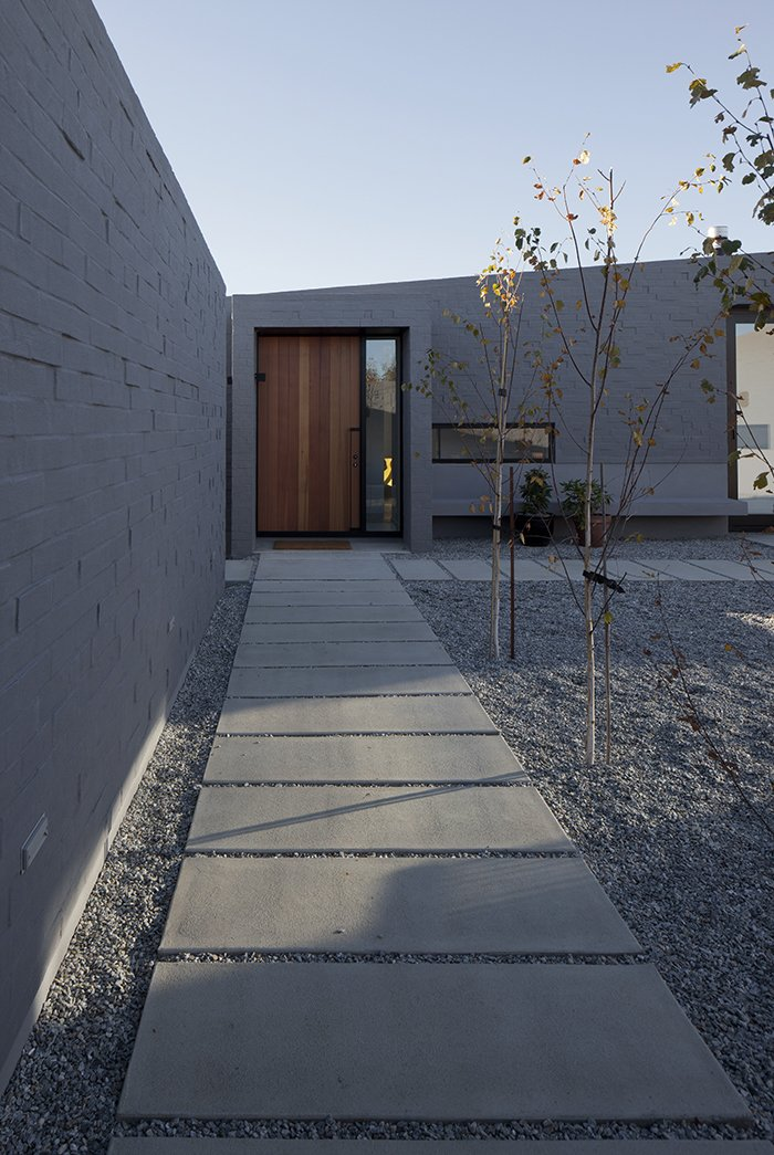 With its expansive, geometric design and wide concrete-slab walkways, the enclosed central courtyard around which the house is organized creates outdoor space protected from the sometimes-inhospitable wind out of the northeast.  Lake Hawea Courtyard House by Sam Eichblatt