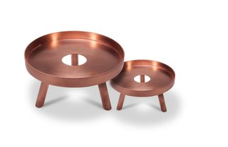 The Lift is both a functional serving piece and an attractive decorative accent. Handcrafted in brushed brass and finished in brushed copper, the Lift includes a circular tray and three balanced supporting legs. The middle of the tray features a simple open circle, adding a sense of cohesion to the piece. The Lift was designed by Felicia Ferrone and is available in two sizes.
