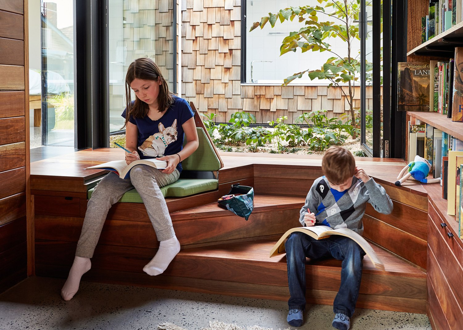 Office, Library Room Type, Bookcase, Storage, and Medium Hardwood Floor Our kids are our future—teach them to be conscientious and kind to Mother Earth with these sweet, informative children's books.  Photo 11 of 12 in This Transformed Melbourne House Resembles a Quirky Village