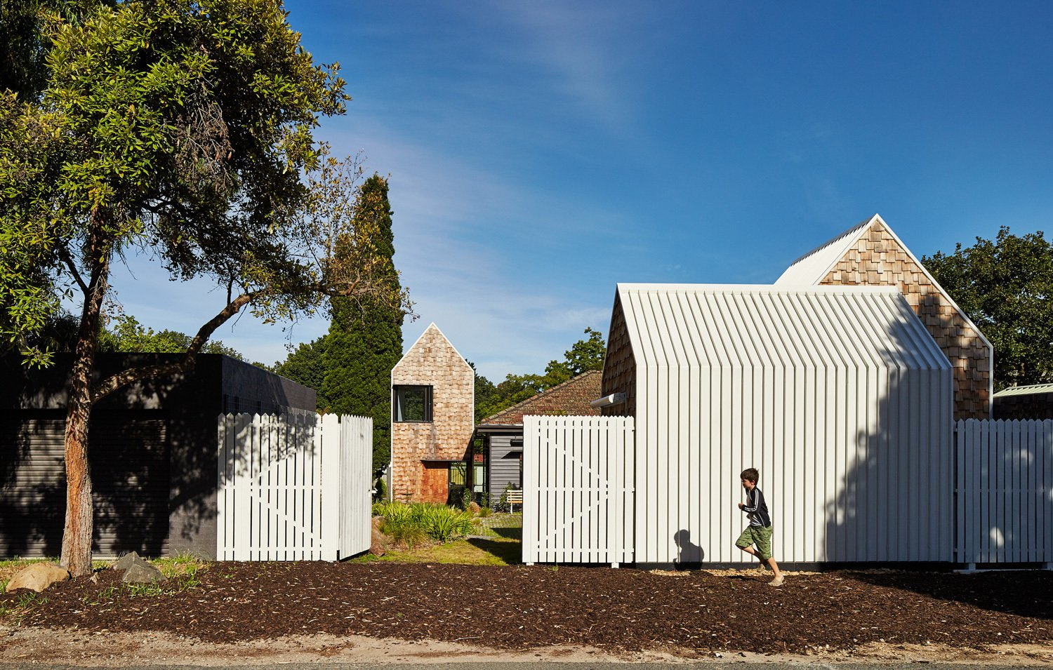 "Outdoor, Vertical Fences, Wall, and Wood Fences, Wall A small country road borders the property to the west.  Search ""fences,-walls--metal"" from This Transformed Melbourne House Resembles a Quirky Village"