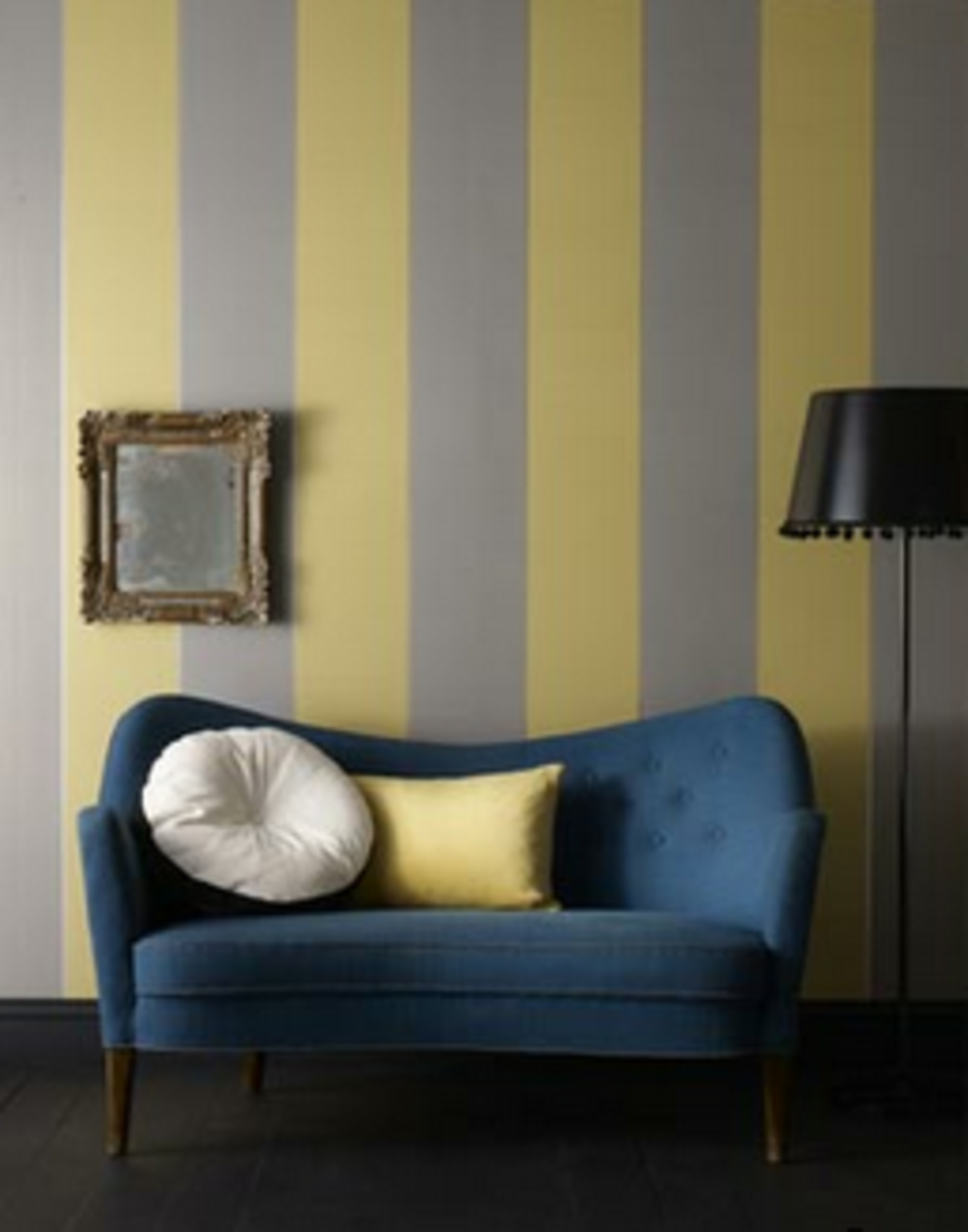 Living Room, Sofa, and Floor Lighting Imperial Wallpaper   From designer staple Graham & Brown, the muted gray and mustard stripes pair nicely with the warm tones in mid-century furniture, $75 per roll.  Photo 13 of 14 in 7 Wallpaper Designs That Will Instantly Revamp Your Space from To the Walls