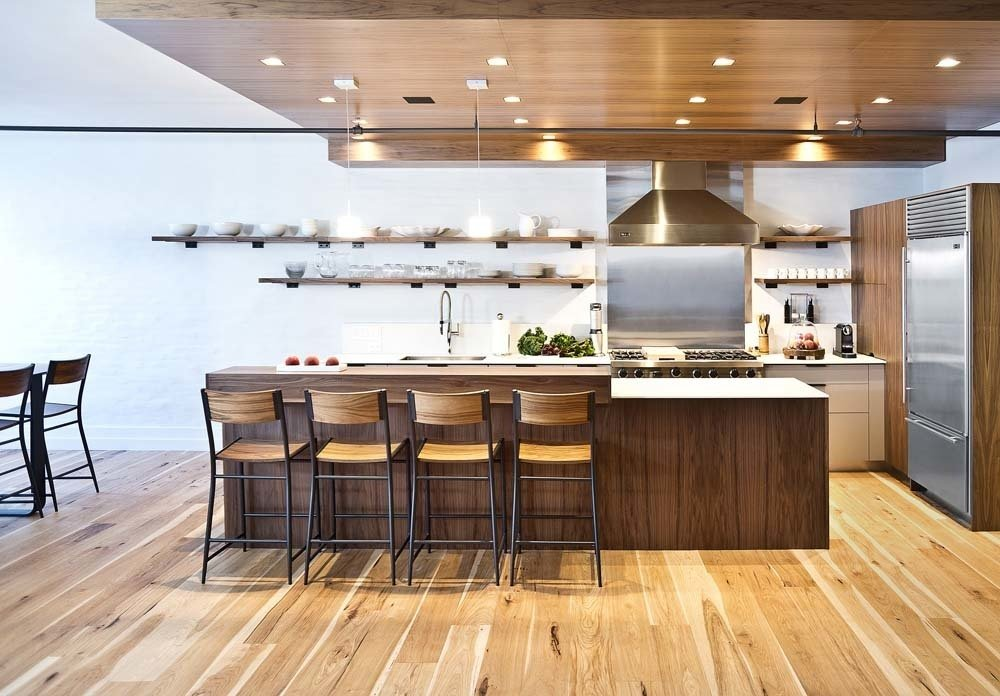 """Kitchen, Wood Cabinet, Recessed Lighting, Pendant Lighting, Range Hood, Wood Counter, Range, and Refrigerator Recessed ceiling lights, speakers, and the range hood ductwork are all concealed by the dropped ceiling. The stools are West Elm.  Search """"kitchensinks--drop-in"""""""