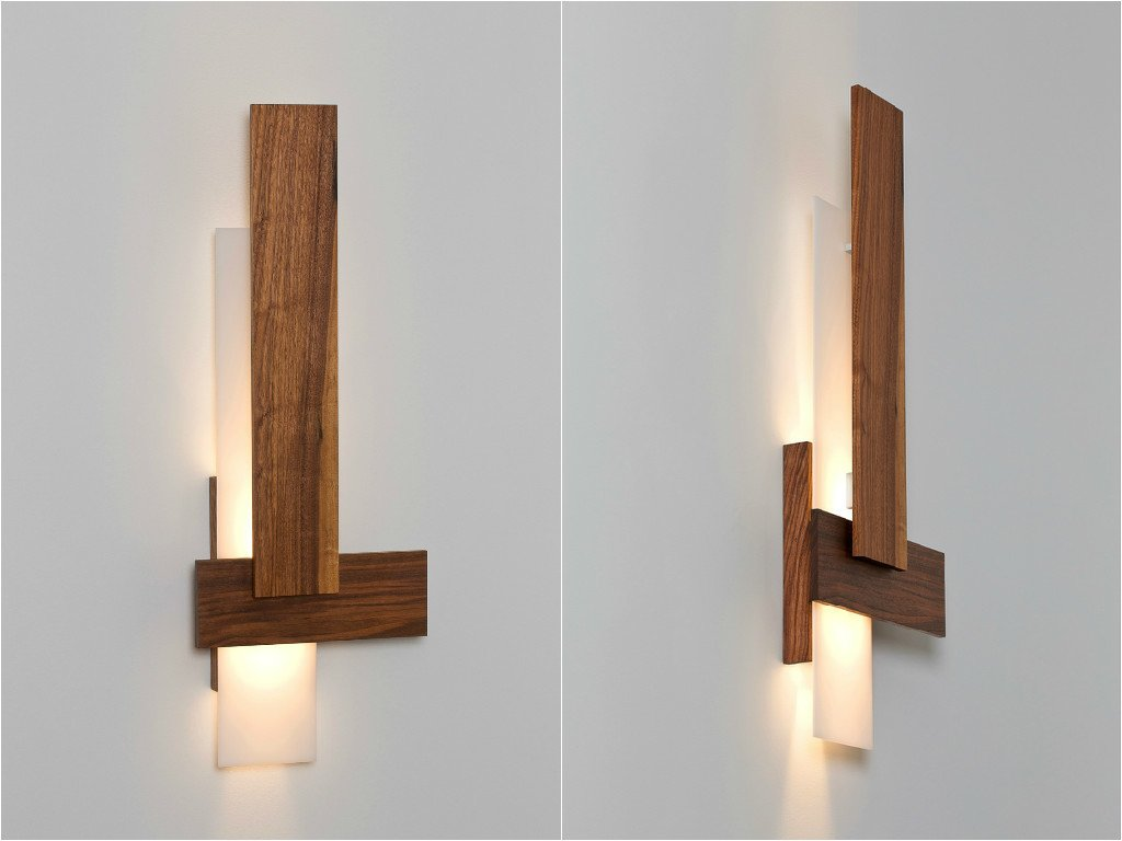 Sedo Wall Sconce. Made of brushed aluminum and walnut, the Sedo is composed of three floating planes, all kept flat against the wall. This simple composition creatively hides the light engine from view and filters the light as it's dispensed up and down the wall.  Modern Lighting Made in America by Brandi Andres