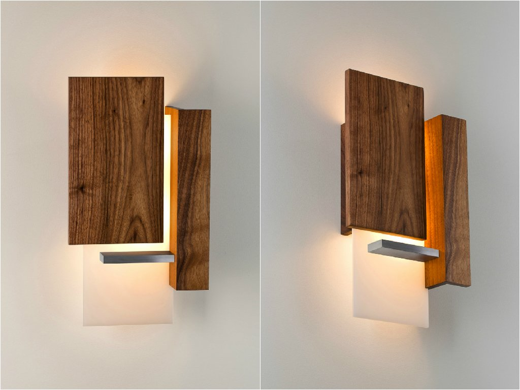 Vesper Wall Sconce. The Vesper is a very simple geometric sculpture composed of brushed aluminum, oiled black American walnut, and white polymer. The Vesper's composition not only offers streaming light upward and downward, but also filters it toward the front of the fixture, where its three-dimensional depth can be fully admired.  Modern Lighting Made in America by Brandi Andres