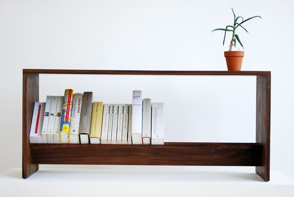 """""""Once I finished designing the LBR-1, I realized it could be used as a nightstand, stool or an end table. With those dimensions sorted out, we then stretched the design into a bench,"""" said Heywood, of the LBR-2, shown here in walnut.  Photo 4 of 6 in A Bibliophile Shares His Book Storage Secrets"""