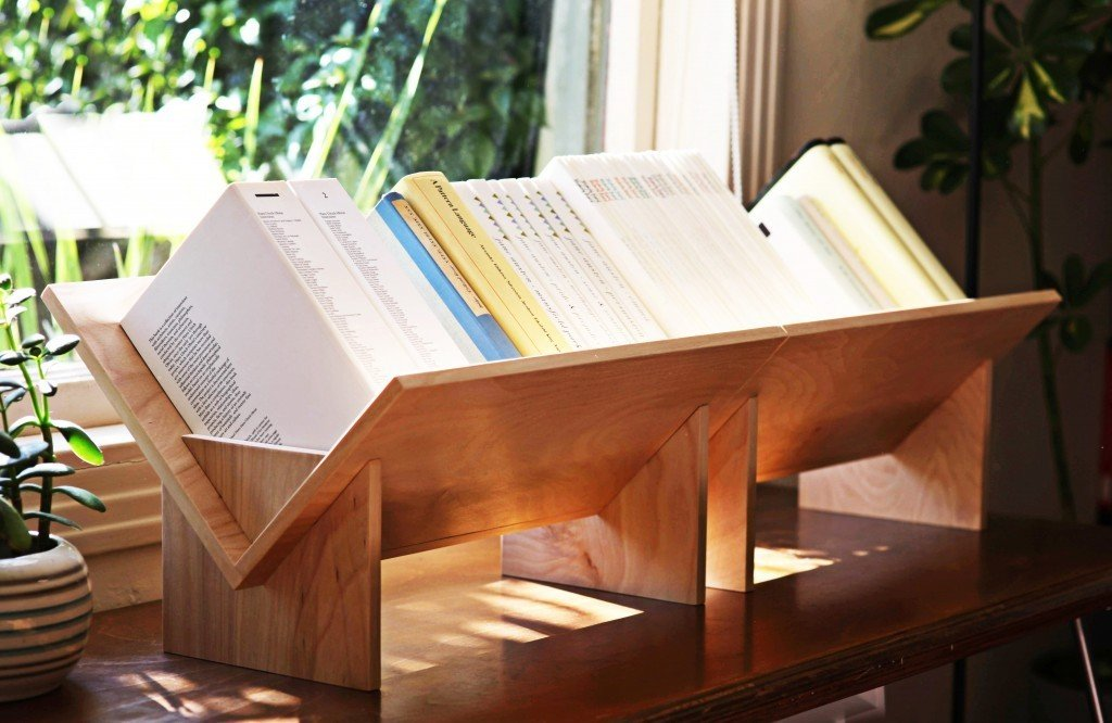 The SSB is made of four pieces that slot together to create the central V design and comes in two types of wood or steel. It can hold an open cookbook in the kitchen, display favorite titles in the living room, and it also works well for kids.  Photo 5 of 6 in A Bibliophile Shares His Book Storage Secrets