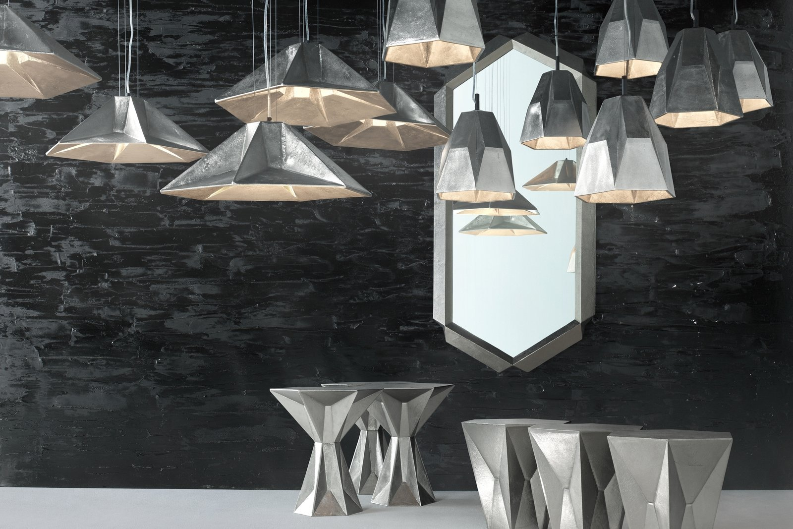 "The Rough and Smooth collection was inspired by the studio's exploration of texture and material weight in contrast with the surfaces created by extreme polishing, sharp lines, and modern manufacturing. Each of the eight product families explores a different shape, such as ""Gem,"" a line of angular lights, tables, and mirrors (pictured).  Tom Dixon's New Collection for Salone 2013 by Olivia Martin"