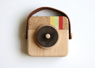 Inspired by the photo sharing app Instagram, the nostalgic Anagram Wooden Camera, $35, sports the same striped colors (minus the blue) and is handmade from sustainable wood, cork, and leather.