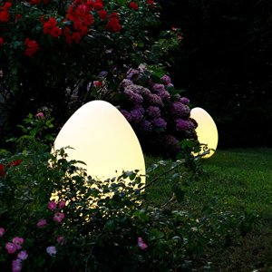 UOVO OUTDOOR LAMP  This outdoor lamp by Archivio Storico for FontanaArte brings new meaning to hiding eggs in the backyard. It's like Easter for adults—only these glowing orbs won't be hard to find and there is most cetainly no candy inside them.