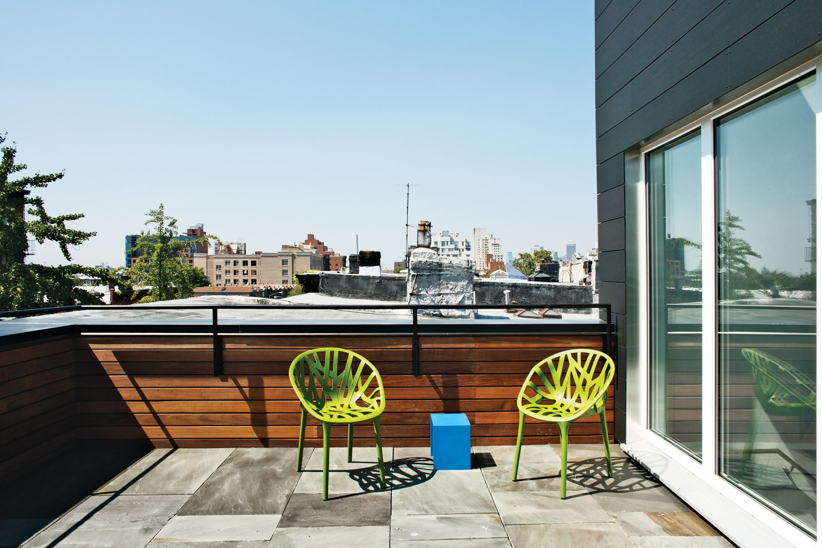 Outdoor and Small Patio, Porch, Deck The designer added a 500-square-foot third floor—hidden from the street—with a small, bluestone roof deck, to create a master suite. The roofline was reoriented due south and covered in a combination of solar thermal panels by Stielbel Eltron (to heat the domestic hot water) and Unirac SolarMount SunFrame with 190w photovoltaic panels (for electricity).  Private Rooftop Sanctuaries  by Zachary Edelson from A Sustainable Brownstone Transformation in Brooklyn