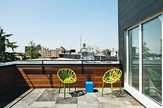 The designer added a 500-square-foot third floor—hidden from the street—with a small, bluestone roof deck, to create a master suite. The roofline was reoriented due south and covered in a combination of solar thermal panels by Stielbel Eltron (to heat the domestic hot water) and Unirac SolarMount SunFrame with 190w photovoltaic panels (for electricity).