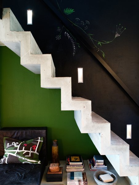 Concrete stairs lead up to the sleeping loft. Photo by Per Magnus Persson.