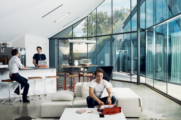 Rodriguez, a designer and architect who runs the studio Agi Miagi, created the pendant lamp and terrariums in the dining area. The space is open to the living area, where Brown's son, Hugo, sits on a Living Divani sofa. The countertop-table is by Bercy Chen Studio.