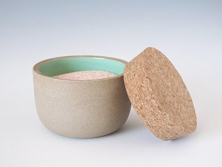 Hand thrown on a potter's wheel, this toasty clay colored jar by Paula Lopez-Otero sports a shiny turquoise glaze inside and is topped with a large cork piece.