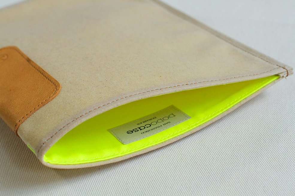 The center pocket of the natural canvas is colorful yellow cotton twill.  Photo 2 of 6 in A Wallet for Your Phone?