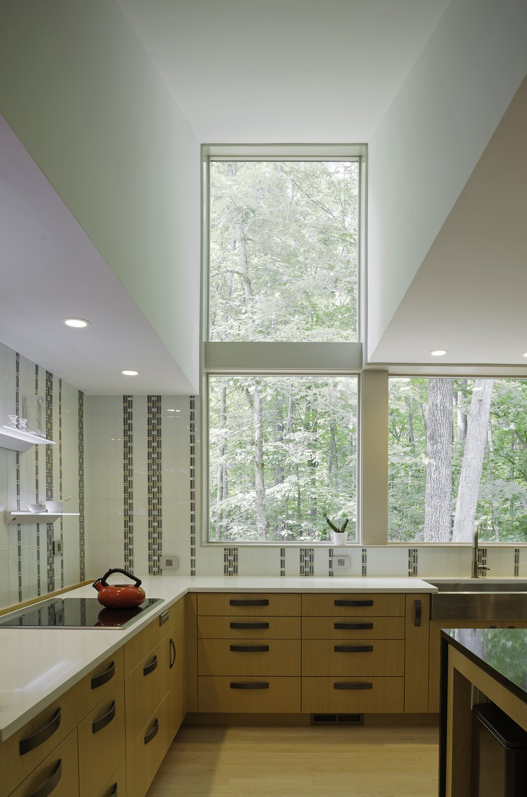 The kitchen features a sink from Kohler, a faucet by Brizo, and a cooktop from Wolf. The tiles are by Everstone. Courtesy of Richard Leo Johnson / Atlantic Archives Inc.  Shining Examples of Clerestory Windows by Luke Hopping from Streamlined Modern Living in the North Carolina Forest