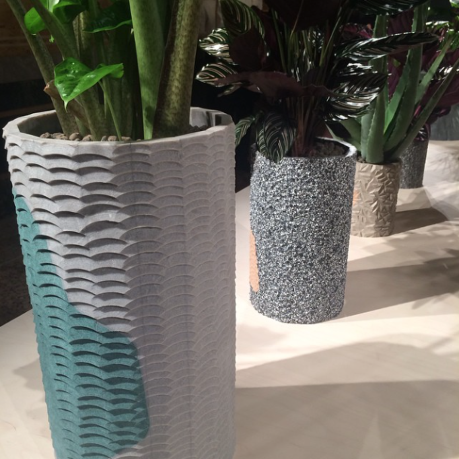 Selection of planters by Philippe Malouin, using inlaying and stone-carving techniques on Caesarstone.  Editors' Picks from Salone del Mobile 2015: Day One by Dwell
