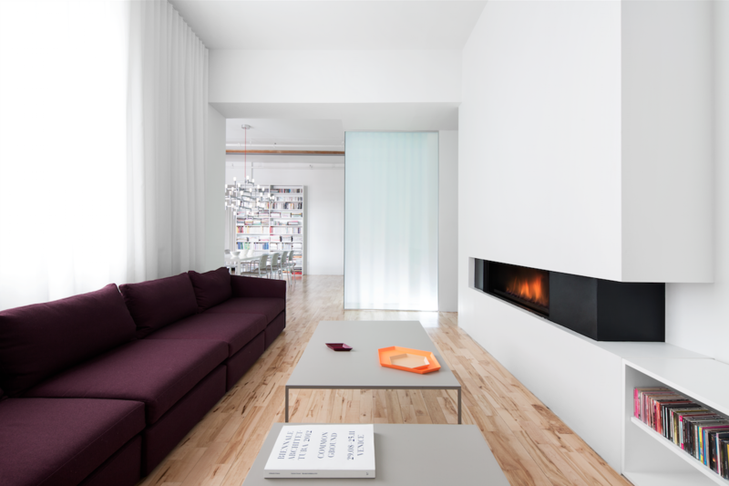 Interior designer Anne Sophie Goneau gave an apartment in a former factory a bright makeover. The minimal gas fireplace is from Ortal, acting as a focal point in the room, complete with integrated shelving.