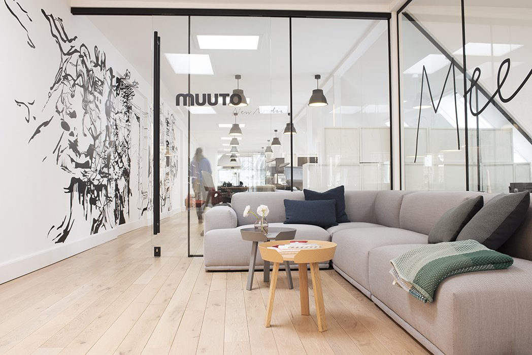 """Visitors to Muuto's headquarters are greeted by high-impact graphic wall art and wraparound glass walls. Brandt describes the look as """"Scandinavian with a New Yorker twist.""""  Photo 1 of 7 in Muuto's Sophisticated Copenhagen Office is All About Transparency"""
