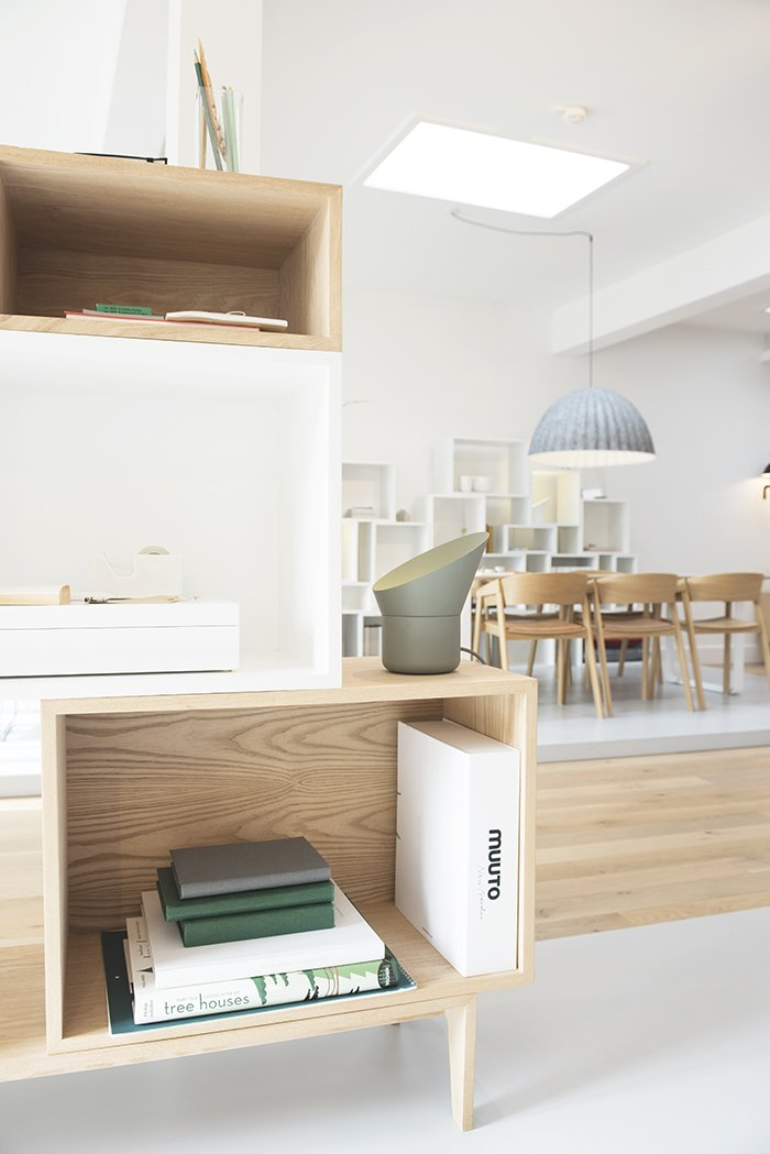 Placing the products in an active environment reveals their potential applications. Stacked shelving systems partition workstations as well as contain books and other household items.  Photo 3 of 7 in Muuto's Sophisticated Copenhagen Office is All About Transparency
